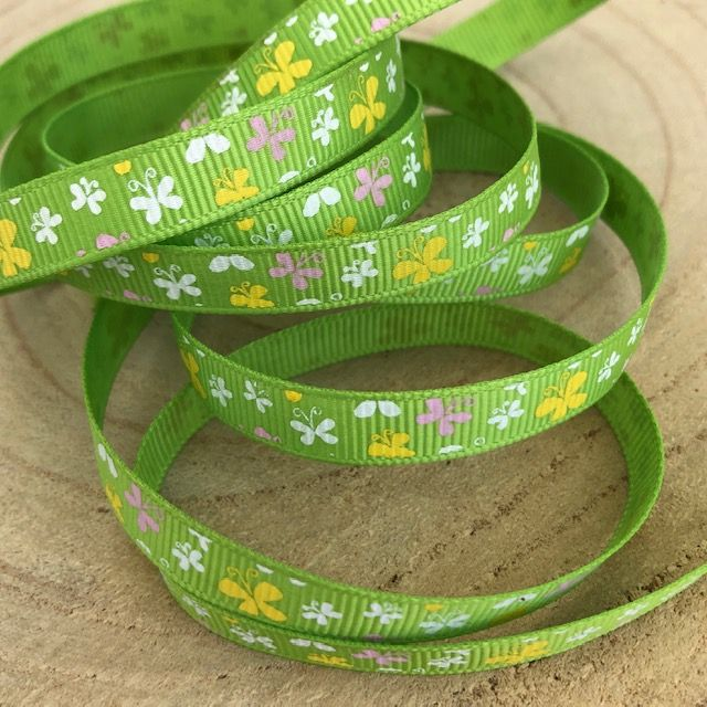 Butterflies in  Yellow, Pink and White on  Green Grosgrain Ribbon 9mm